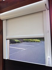 Laser blocking roller blinds